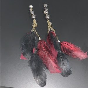 Feather adorned stud earrings